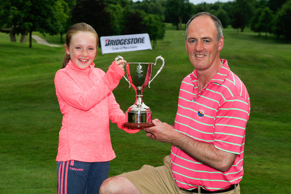 Eddie McCormack and his daughter Aoife show off the Connacht Stroke Play Championship trophy after his victory at Portumna