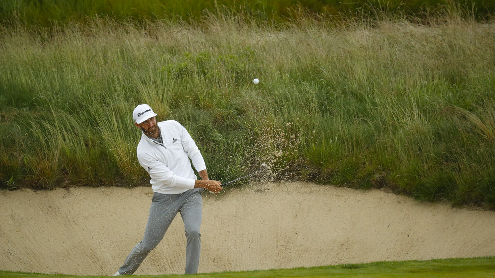 Dustin Johnson plays a bunker shot on the 17th hole during the second round of the 2018 U.S. Open at Shinnecock Hills Golf Club in Southampton, N.Y. on Friday, June 15, 2018.  (Copyright USGA/Jeff Haynes)