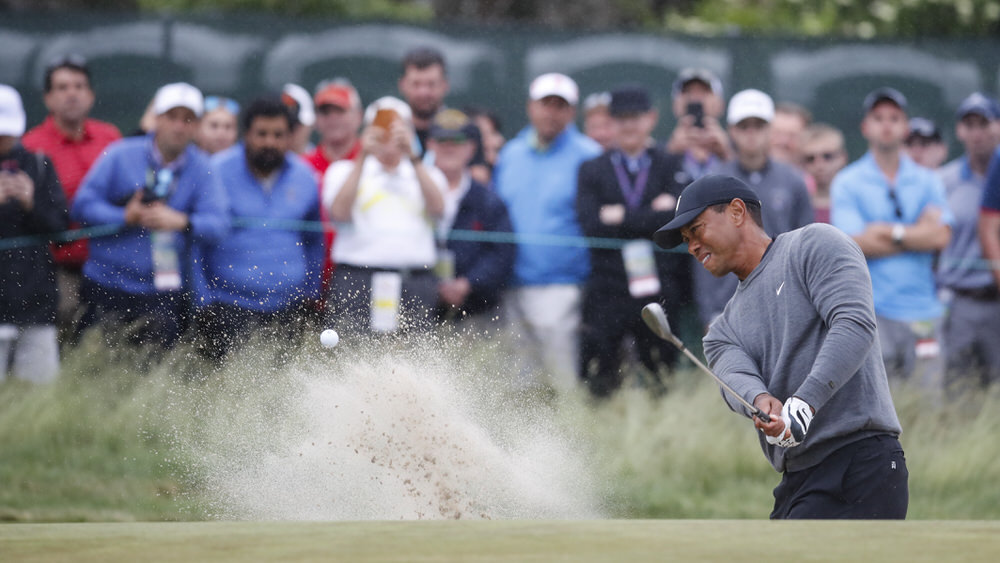 Tiger Woods plays a bunker shot on the 15th hole during the second round of the 2018 U.S. Open at Shinnecock Hills Golf Club in Southampton, N.Y. on Friday, June 15, 2018.  (Copyright USGA/Jeff Haynes)