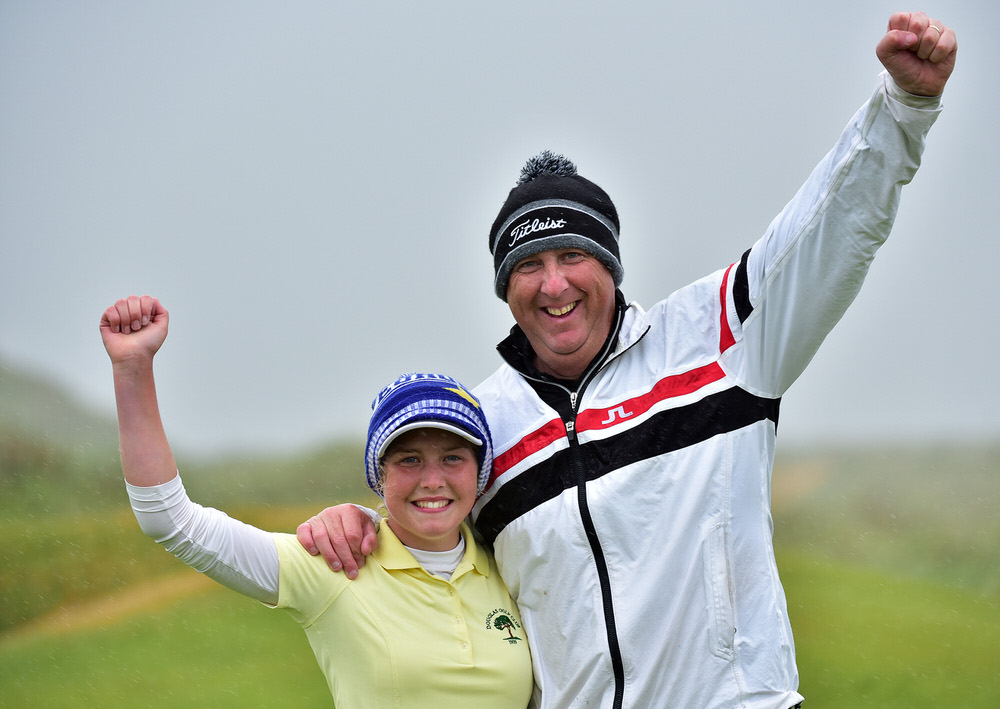 Sara Byrne (Douglas) with her caddy father Derek after holing the winning putt on the 17th green to win the 2018 Irish Women's Close Amateur Championship at Enniscrone Golf Club. (19/06/2018). Picture by  Pat Cashman