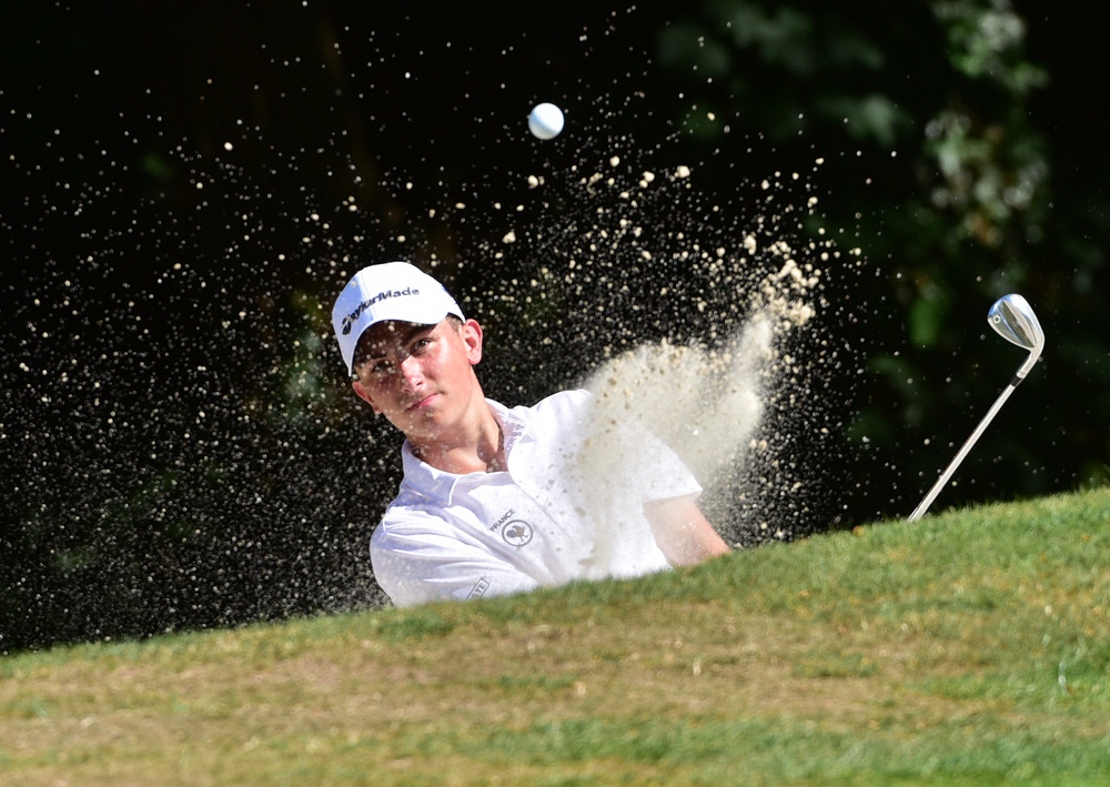 Theo Boulet (France) holes his bunker shot at the 4th green during the second round of the 2018 Irish Boys Amateur Open Championship at Belvoir Park Golf Club. Picture by  Pat Cashman