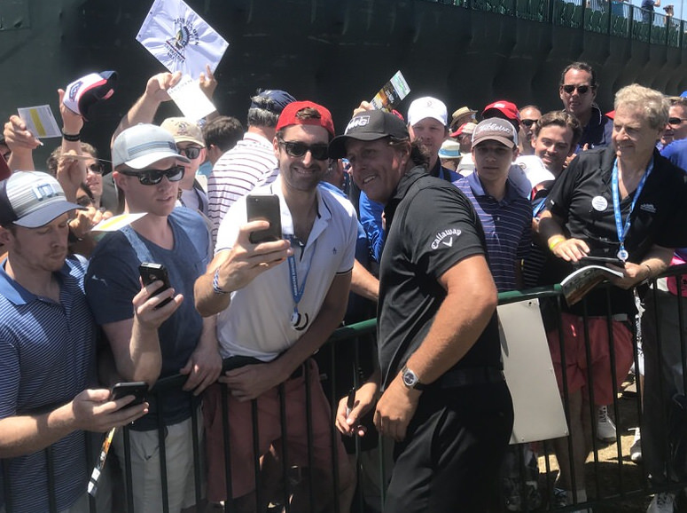 Phil Mickelson poses for photos with fans the day after his meltdown at Shinnecock Hills