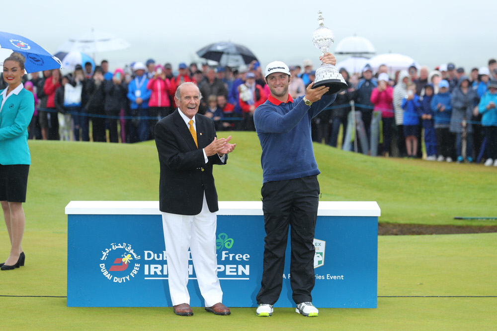 Jon Rahm of Spain receives the trophy from Colm McLoughlin the Executive Vice Chairman and CEO of Dubai Duty Free after his victory during the final round of the Dubai Duty Free Irish Open at Portstewart Golf Club on July 9, 2017 in Londonderry, Northern Ireland. (Photo by Warren Little/Getty Images)