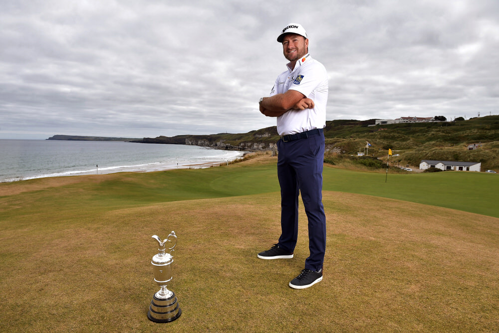 PORTRUSH, NORTHERN IRELAND - JULY 09: Graeme McDowell, Major Champion and Mastercard Global Ambassador, returned to Royal Portrush Golf Club to mark the going on sale of the first tickets to The 148th Open which will be held at the famous links from 14-21 July 2019 on July 9, 2018 in Portrush, Northern Ireland. Tickets are on sale through The One Club which is a free to join membership programme. Visit TheOpen.com/PortrushTickets for more information and save £5 on your order when paying with a Mastercard. (Photo by Charles McQuillan/R&A/R&A via Getty Images)