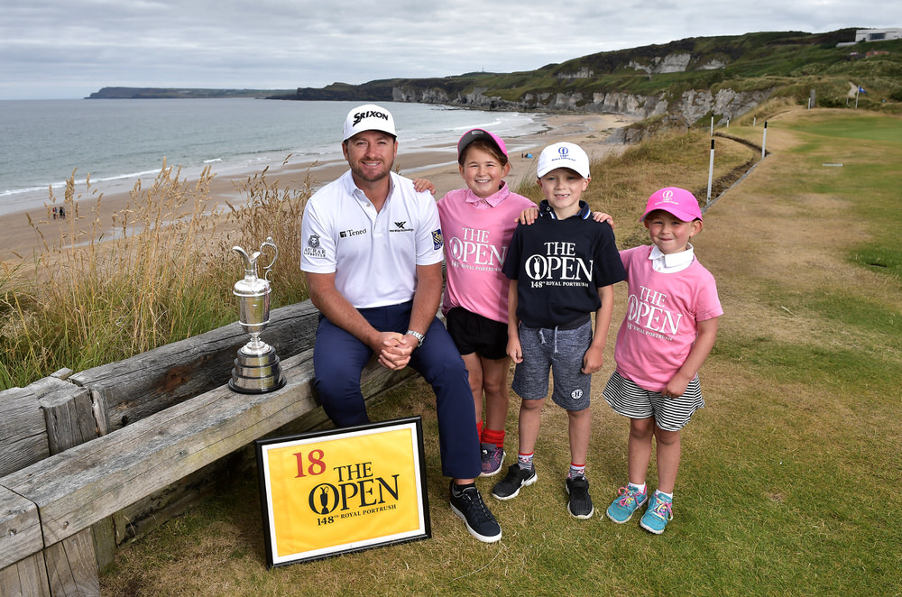 PORTRUSH, NORTHERN IRELAND - JULY 09: Graeme McDowell, Major Champion and Mastercard Global Ambassador, returned to Royal Portrush Golf Club along with Charlotte Beatt, Emily Beatt and Josh Ervine to mark the going on sale of the first tickets to The 148th Open which will be held at the famous links from 14-21 July 2019 on July 9, 2018 in Portrush, Northern Ireland. Tickets are on sale through The One Club which is a free to join membership programme. Visit TheOpen.com/PortrushTickets for more information and save £5 on your order when paying with a Mastercard. (Photo by Charles McQuillan/R&A/R&A via Getty Images)