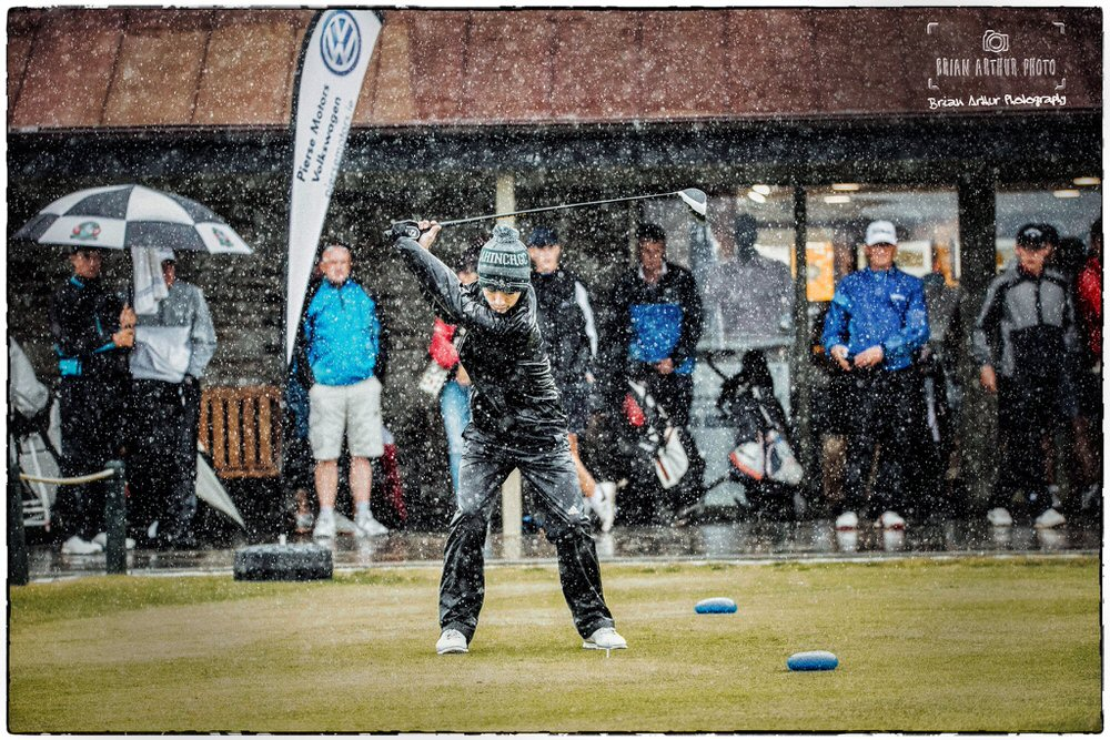 Rory Williamson (Holywood) tees of the 1st in the driving rain during the second qualifying round at the South of Ireland Championships at Lahinch. Play was suspended shortly afterwards and the round abandoned. Picture © Brian Arthur