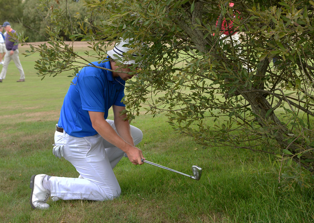 Alex Gleeson (Castle) plays from a bush at the 7th hole during the AIG 2018 Irish Amateur Close Championship at The European Club. Picture by  Pat Cashman