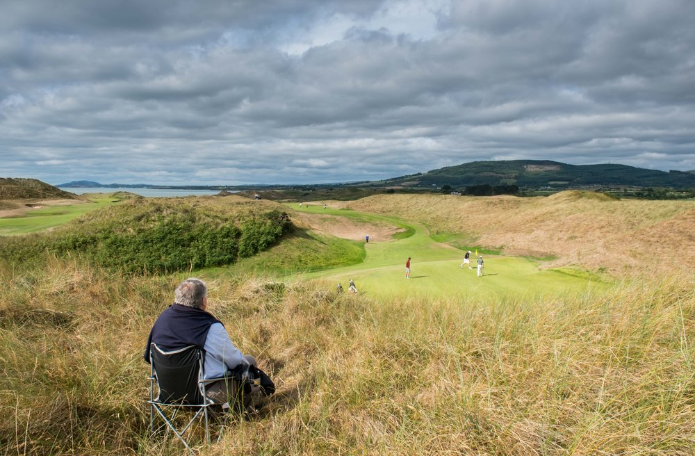 A lone spectator had a magnificent private seat in the dunes above the 8th hole to enjoy the day's golf at the AIG Irish Amateur Close Championship. Picture © Gerry Ruddy