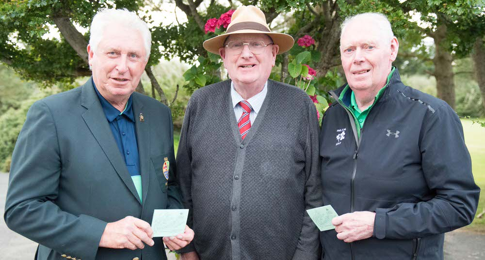 Pat Ruddy (centre), President of The Eurpean Club, conferred Honorary Life Membership on current GUI President John Moloughney and President-elect Jim McGovern.
