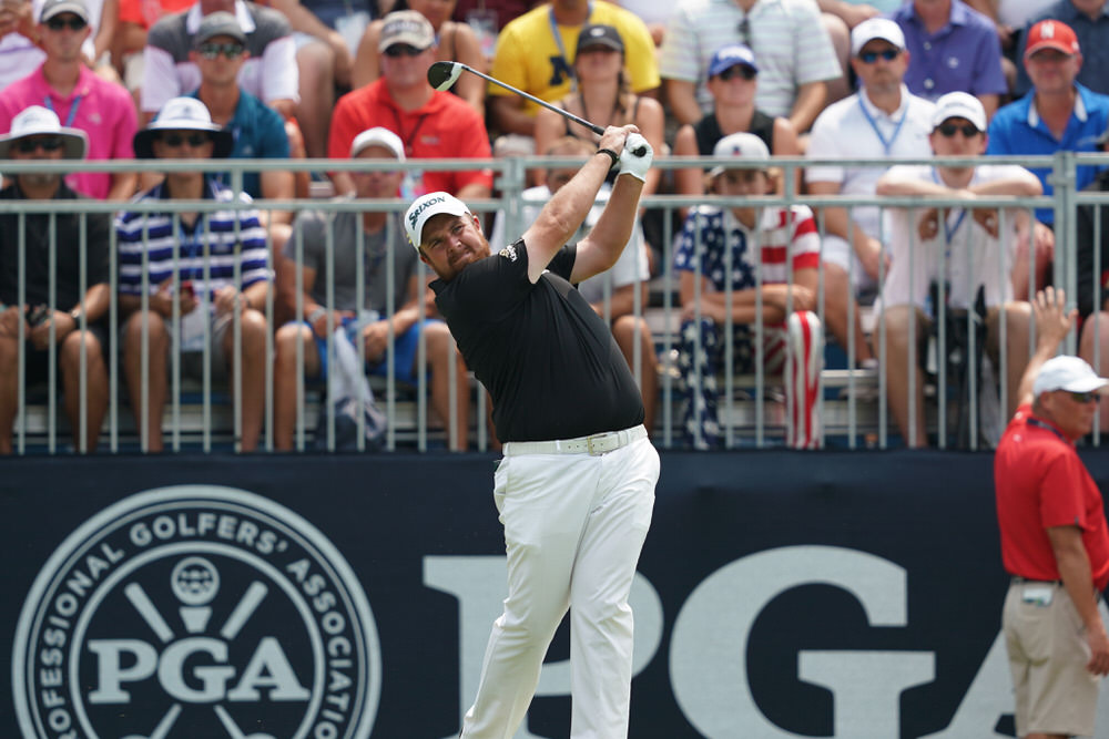 ST. LOUIS, MO - August 12: Shane Lowry hits his tee shot on the first hole during the final round of the 100th PGA Championship at Bellerive Golf Club in St. Louis, Missouri. Photo by Montana Pritchard/PGA of America