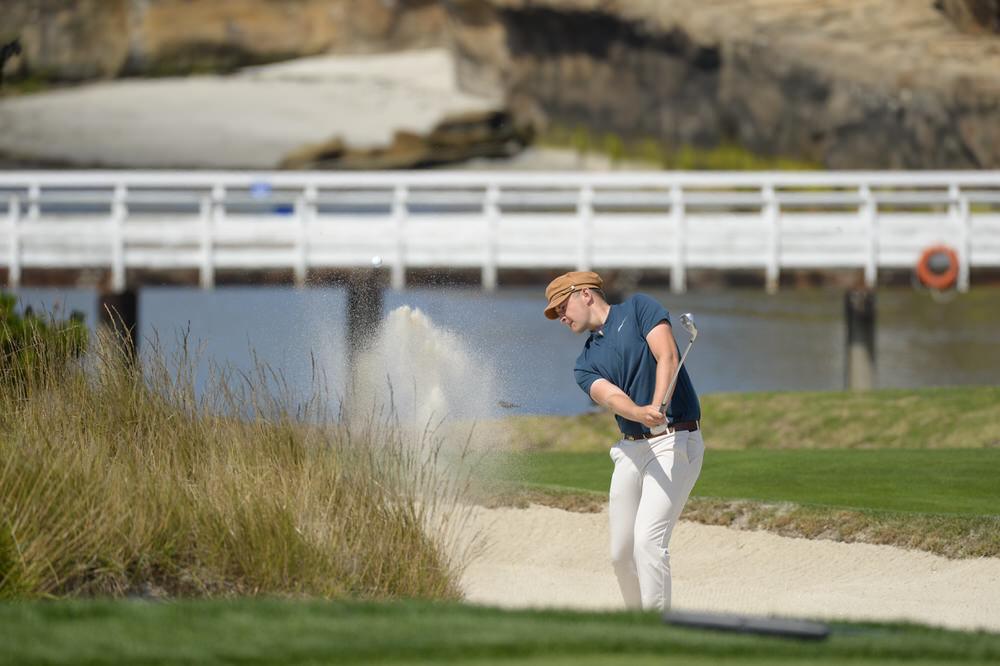 Harry Hall plays his second shot on the fourth hole during the round of 64 at the 2018 U.S. Amateur at Pebble Beach Golf Links in Pebble Beach, Calif. on Wednesday, Aug. 15, 2018.  (Copyright USGA/JD Cuban)