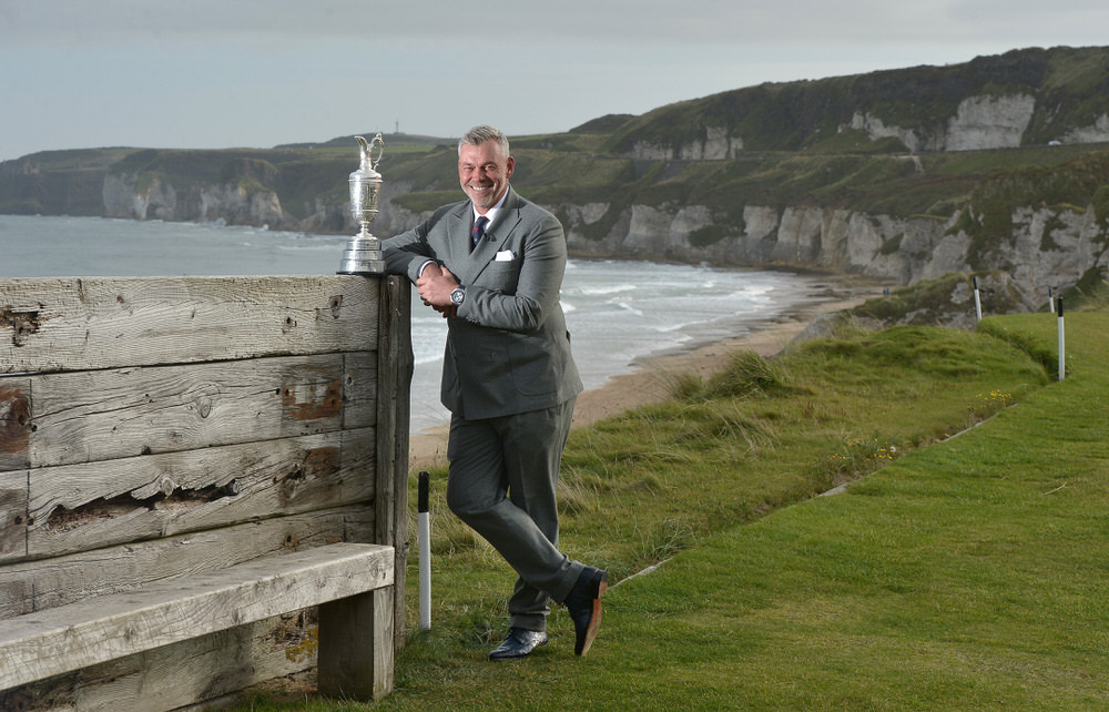 PORTRUSH, NORTHERN IRELAND - OCTOBER 20:  Ryder Cup captain and former Open winner Darren Clarke stands with the claret jug on the 6th tee at Royal Portrush Golf Club overlooking the White Rocks on October 20, 2015 in Portrush, Northern Ireland. It was announced this morning at the famous links course that the 148th Open will take place at Royal Portrush in 2019, marking a historic return to the province for golf's oldest competition after nearly 70 years.  (Photo by Charles McQuillan/Getty Images)