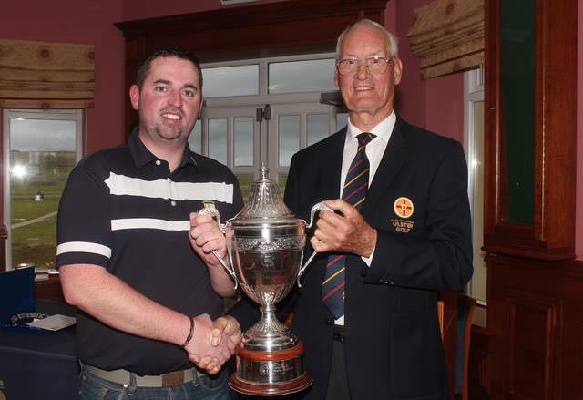 Thomas O'Connor receives the Ulster Mid-Amateur trophy from Eamonn O'Connor (Ulster Branch)