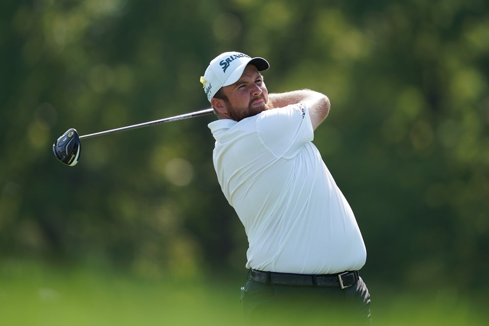 Shane Lowry hits his tee shot on the 13th hole during the third round of the 100th PGA Championship at Bellerive in St. Louis, Missouri in 2018. Photo by Montana Pritchard/PGA of America