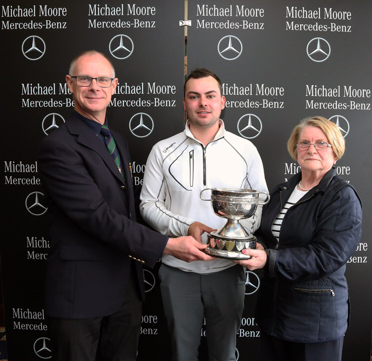 Bryan O'Looney (Captain, Athlone GC) and  Mary McHale, (President Athlone GC) present the De Lacy Staunton Scratch Cup, sponsored by Michael Moore Car Sales, to winner David Reddan ( Nenagh GC).