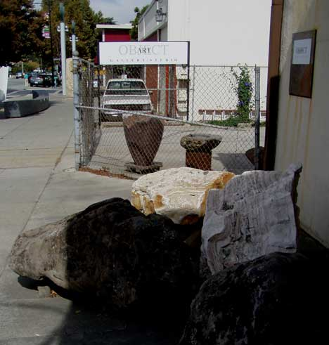 At the entrance to Art Object Gallery/Studio, sculptor Ken Matsumoto's raw materials stand guard.