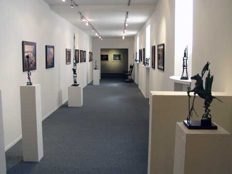 Part of the Gallery most damaged by fire is beautifully remodeled, now featuring small bronzes by Terry Kreiter and Darrel Phelps, along with paintings and prints by Mark Bryan.