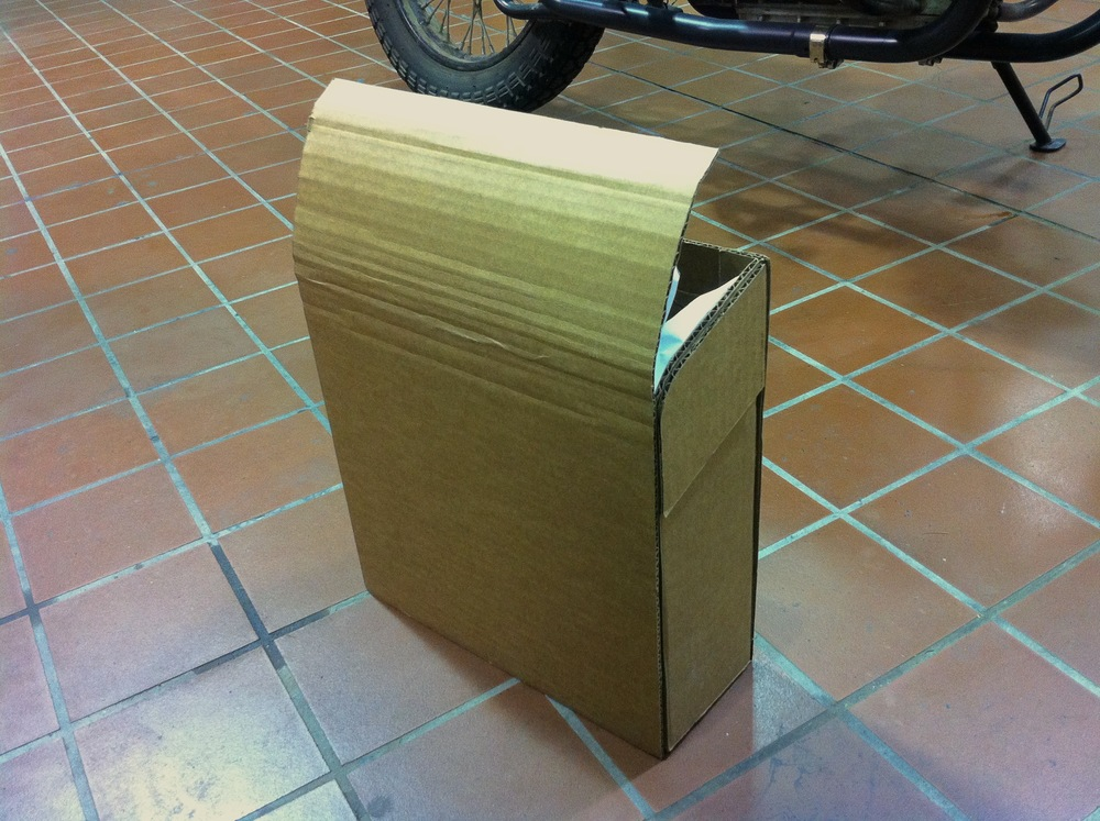 Cardboard prototype with curved top flap.