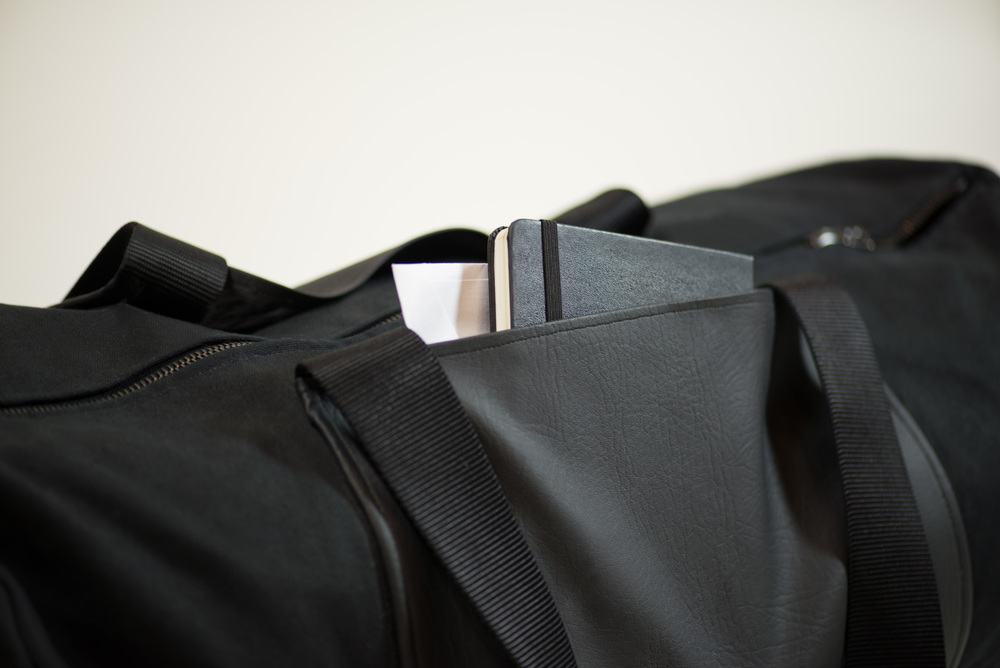 Outer side pockets provide the space for quick access items.