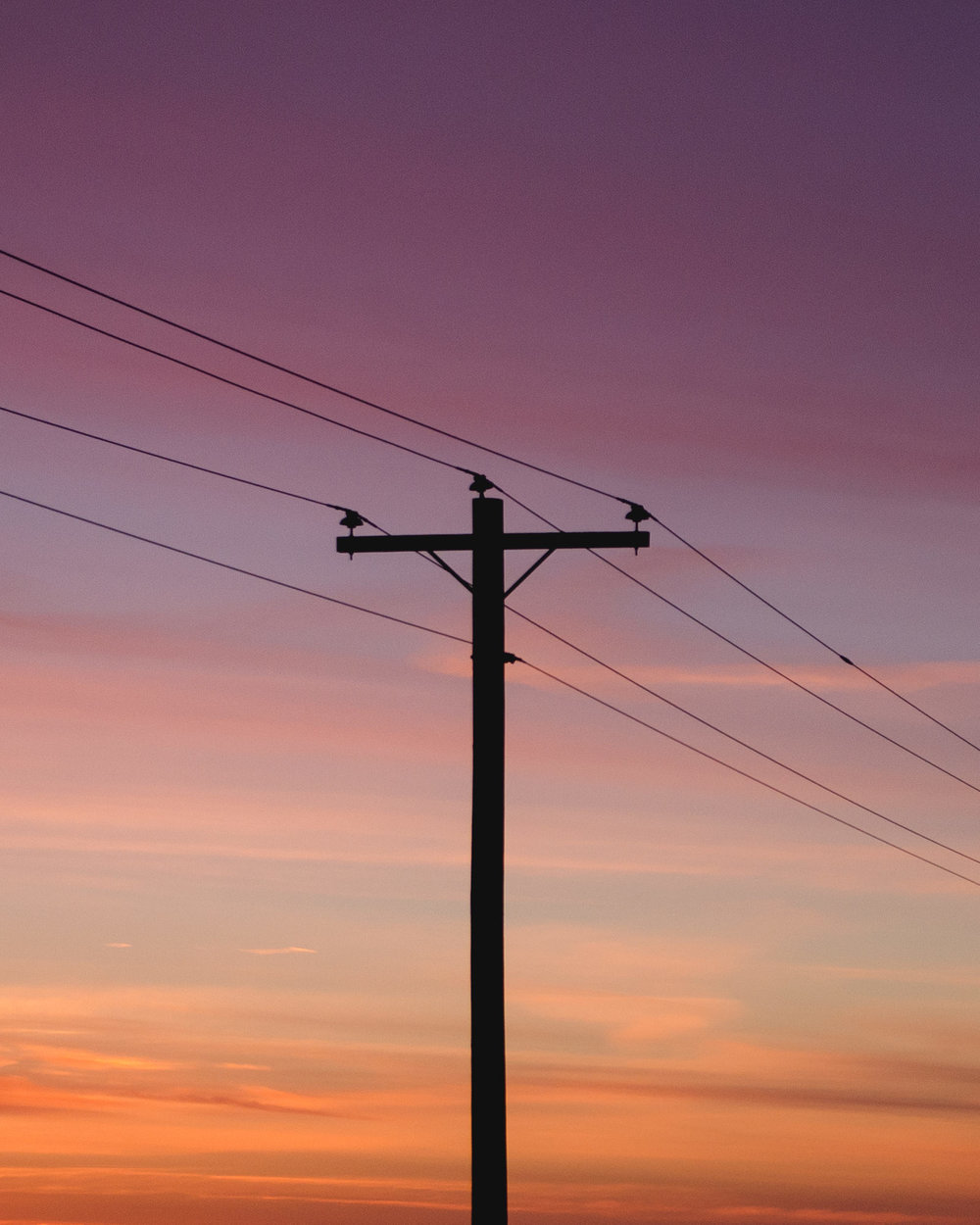 polar-visual-taylor-sheppard-photography-photo-video-motion-design-graphic-stonewall-winnipeg-manitoba-sunset-powerline-hydro-sky-clouds-minimal-silhouette.jpg