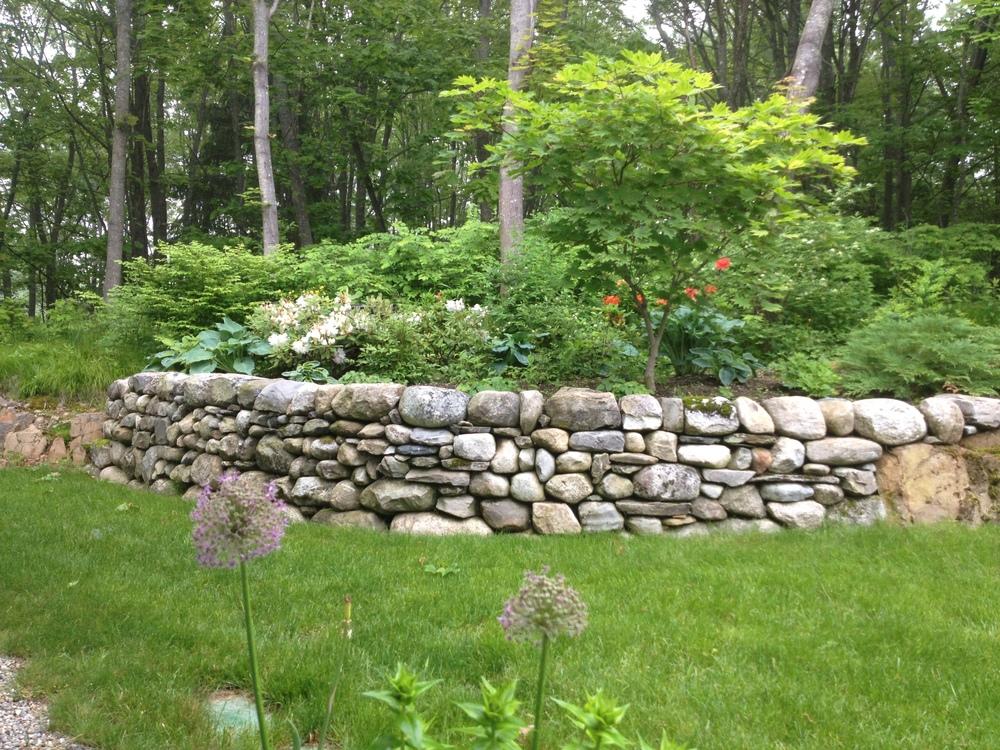 dry stone wall fieldstone retaining Brian Fairfield Maine builder.JPG