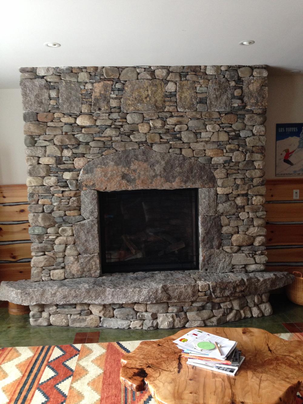 huge stone fireplace maine basement 1 brian fairfield builder.jpg