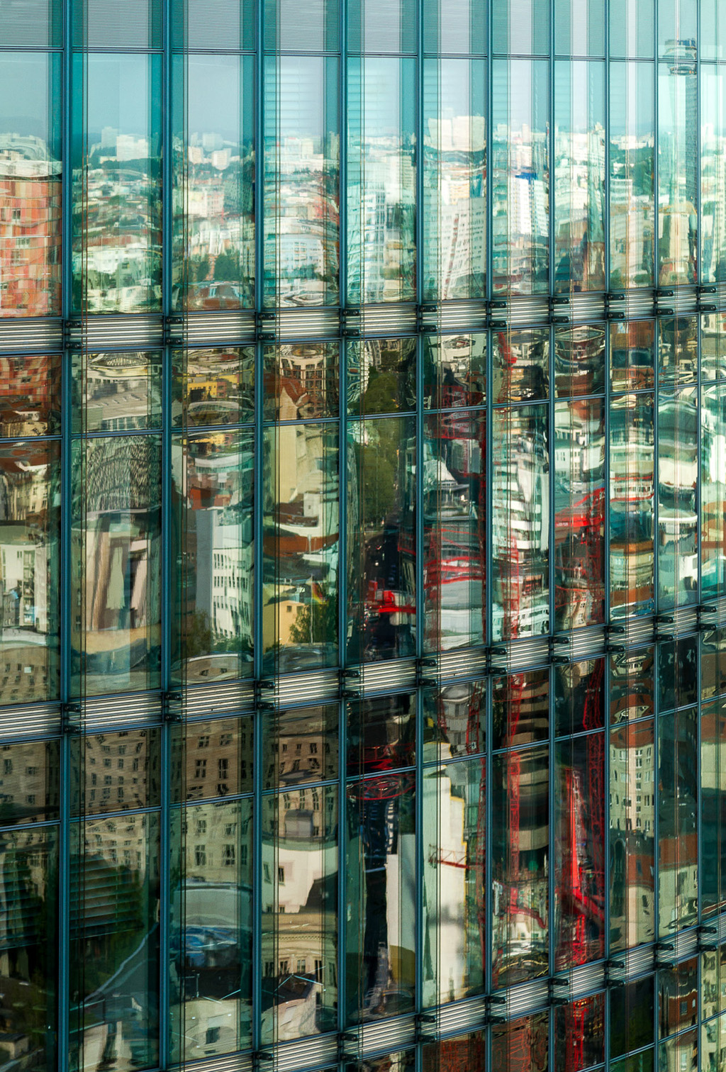 Colours of the city  Patterns reflected on the Murphy+Jahn designed Bahntower in Postdamer Platz, Berlin.