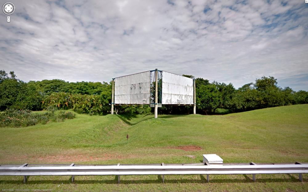 Guarulhos, rusting billboards.