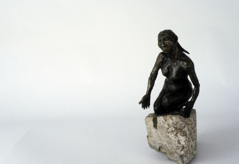 The Woman on the Rock