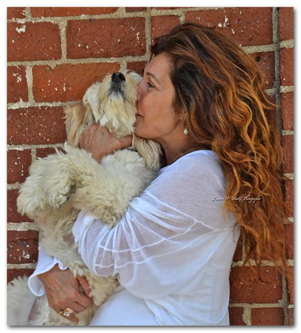 woman holding dog photo artist