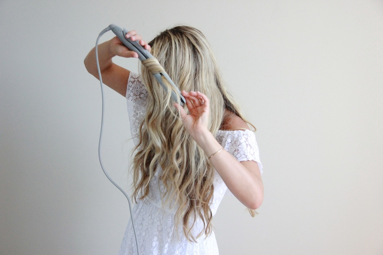Cara jourdan wavy hair tutorial with flat iron repeat through the rest of your hair i sometimes clip up layers to make it easier to work through then let them down as i finish each section urmus Gallery