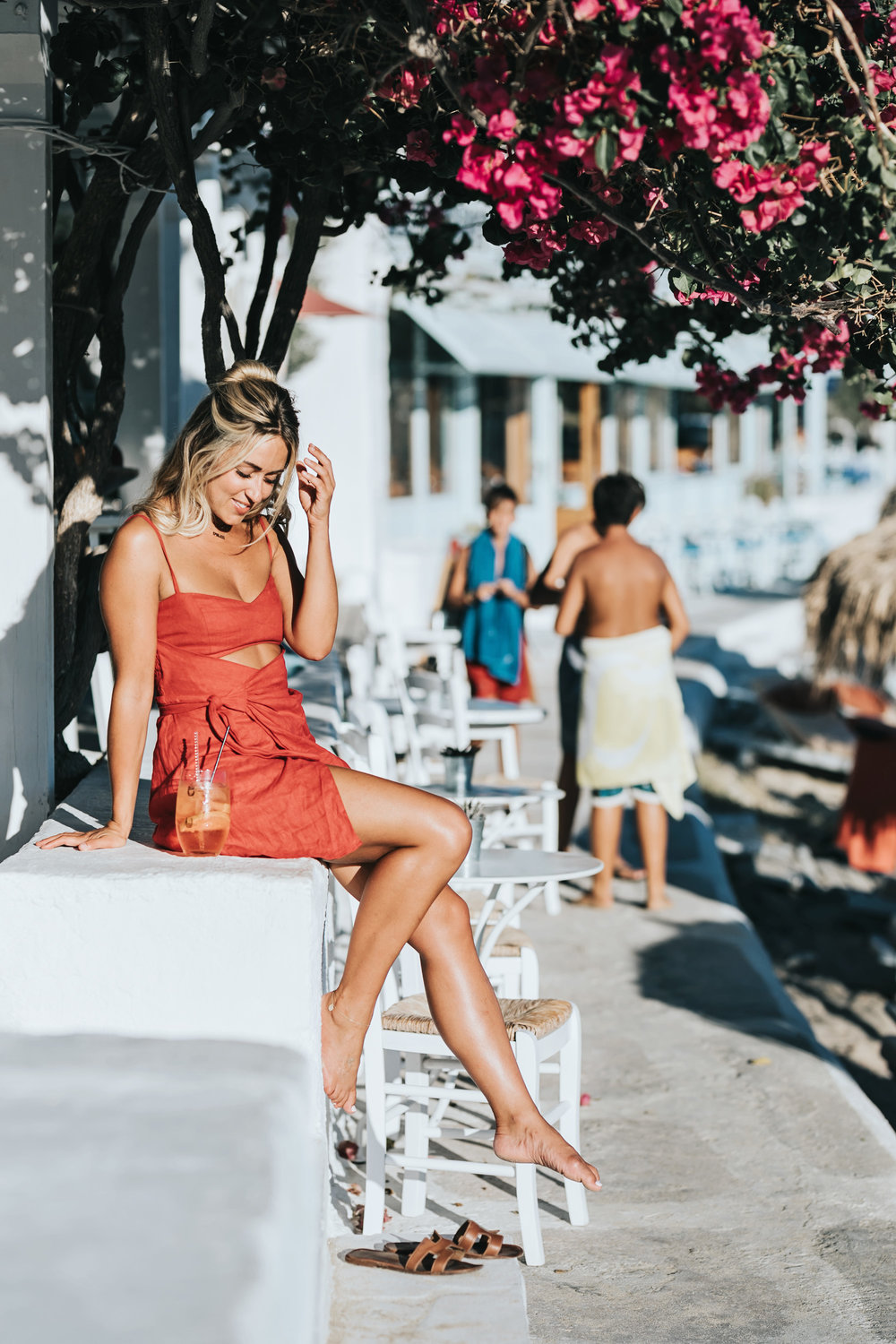 Photos by  Allison Kuhl   Majorelle  Dress from  Revolve | Faithfull The Brand Swimsuit |  Reformation  Dress, Solodus Heels,  CJxMA  Melanie Auld Hoop Earrings | Beach Riot Swimsuit |  Reformation  Dress