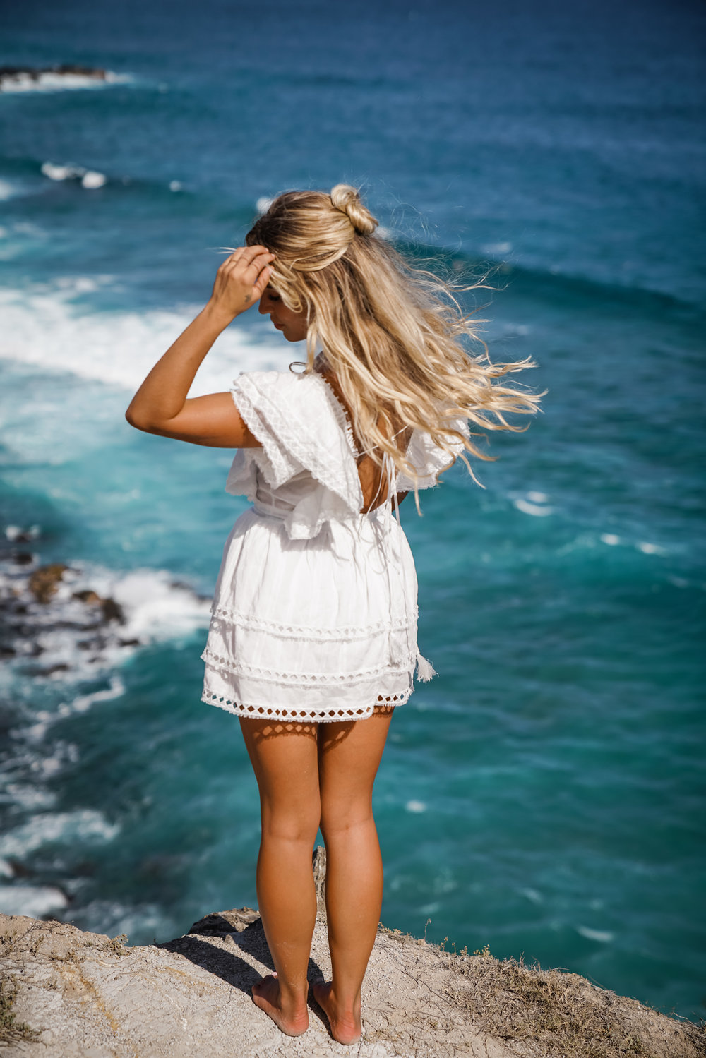 Photos by Kat Reynolds Sabo Skirt Dress | Koa Shop Top, GRLFRND Skirt via Revolve, CJxMA Island Earrings | Gooseberry Seaside Bikini| Lovers + Friends Dress via Revolve | Majorelle Dress via Revolve | Gooseberry Seaside Suit | SIR The Label Dress