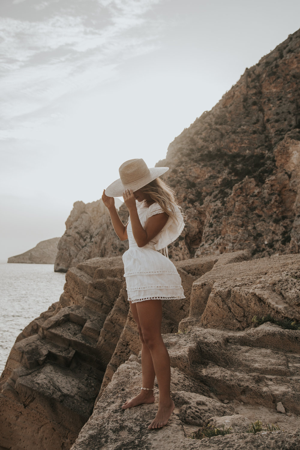 Photos by Paige Owen Lahana Swim Suit | Sir The Label Dress | Lack of Color Hat