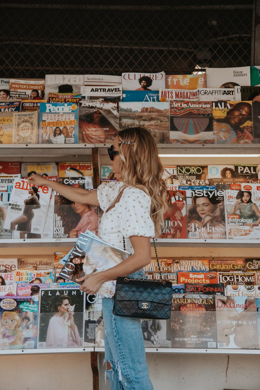 Photos by Paige Owen  LPA  Top Via  Revolve  |  Levi' Jeans  | Chanel Bag |  Jennifer Behr Hair Clip Via BHLDN  |  Saint Laurent  Heels