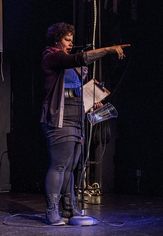 Nikkita Oliver, hosting the Seattle Poetry Slam, 1/29/2014