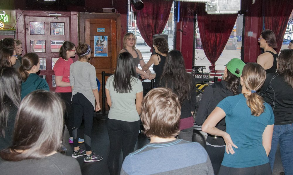 Brooke Wylie demonstrates a self-defense move during a free course at WildRose Bar on Jan 6.jpg