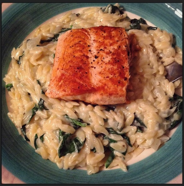 """Cook more"" achievement unlocked! Salmon over creamy parmesean orzo with spinach."