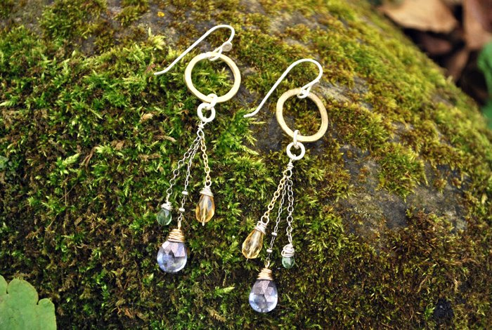 Mixed Media Earring:   Sterling silver, brass  & 14k goldfill accented with peridot, lavendar crystal & citrine gemstones.