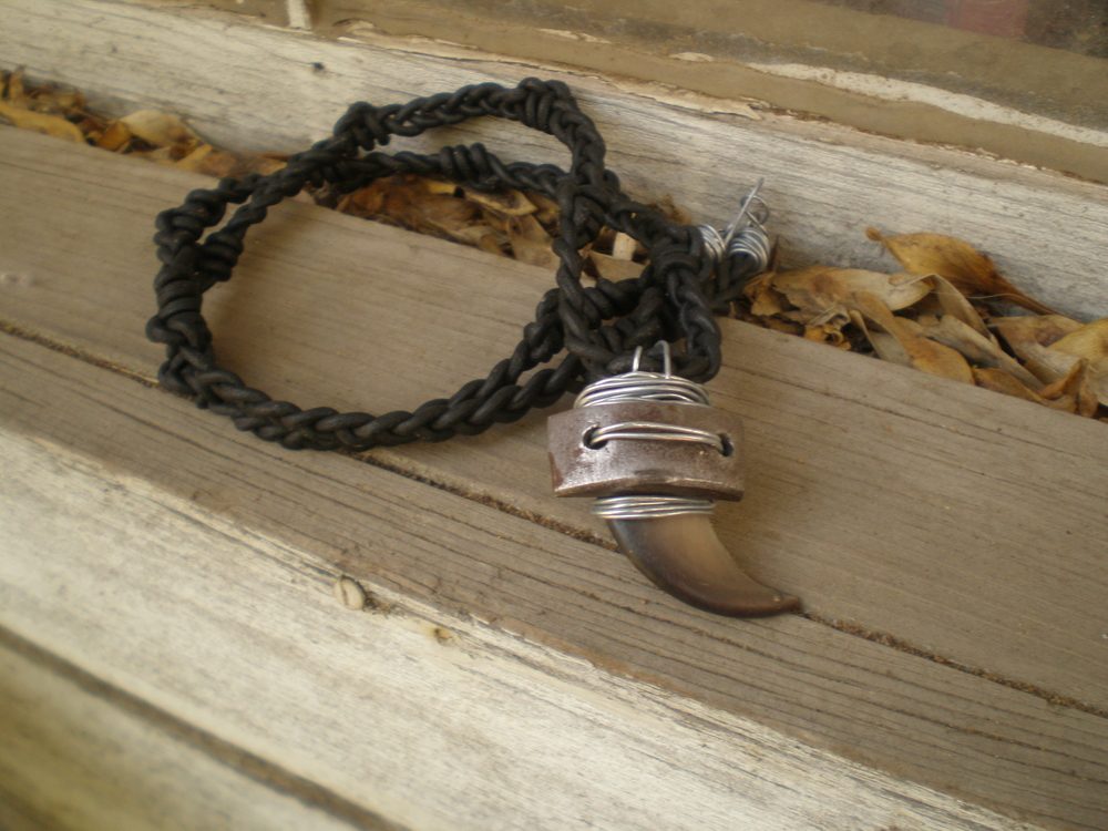 Man-ly Bearclaw Necklace  : Have a special hunk in your life that you would LOVE to accessorize? Well, I would like to accept the challenge. This necklace included such things as a bearclaw, motorcycle part, steel & hand-braided/macrame d  leather cord. What man wouldn't love all of this man-ly man-ness?!