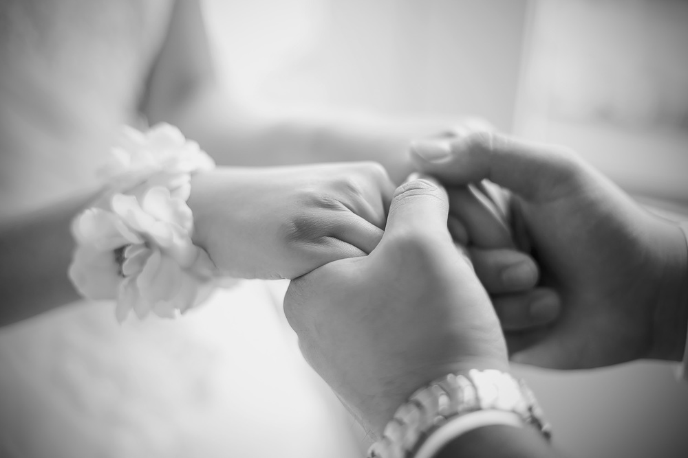 Bride Reveal Black and White Film Style Photo holding hands 5
