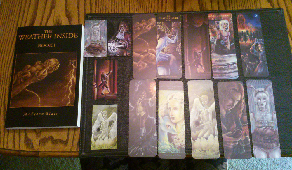 My book and each of the available magnet/bookmark designs! (Magnets are the smaller ones toward the left.)