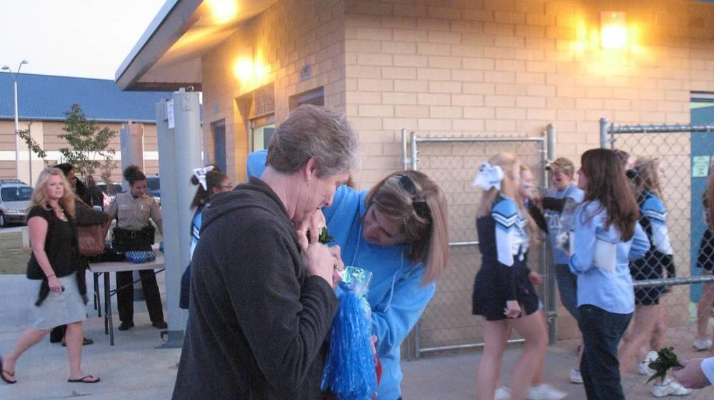 Alumna Carolyn Stevenson receiving VIP treatment from Angela Finn at Homecoming..jpg