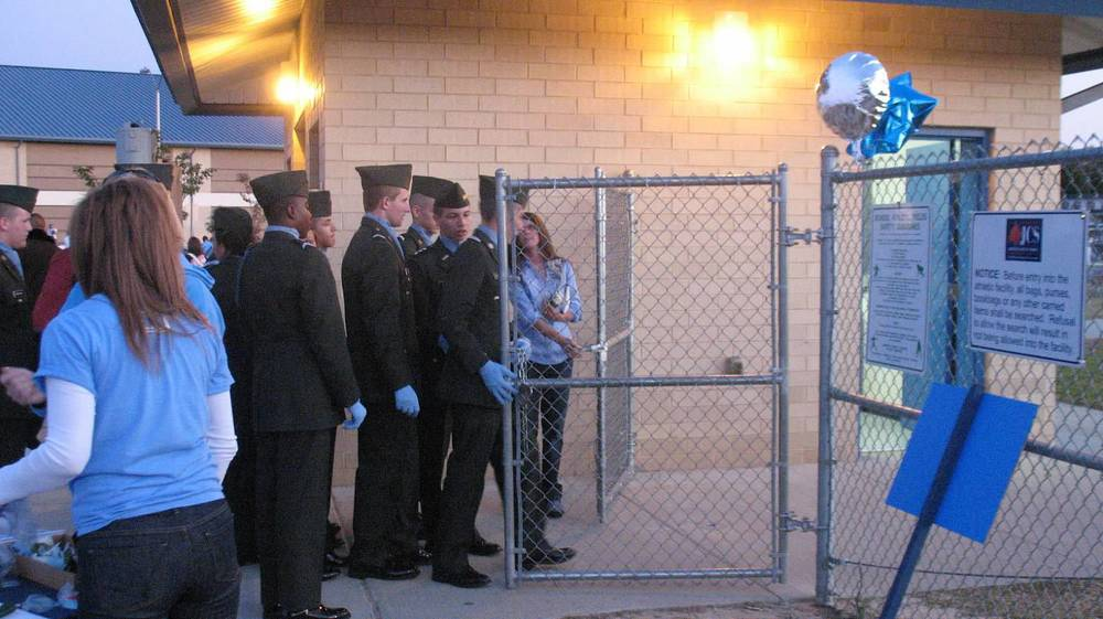 JROTC Makes pre-game Homecoming entrance w help from Booster President Robin App.jpg