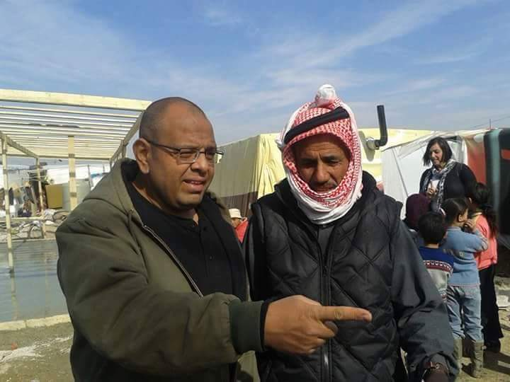 Dr. Hany working with Syrian refugees