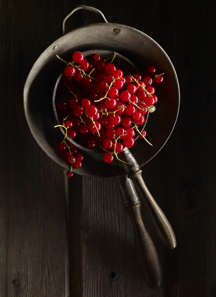 Red currants in old sieves