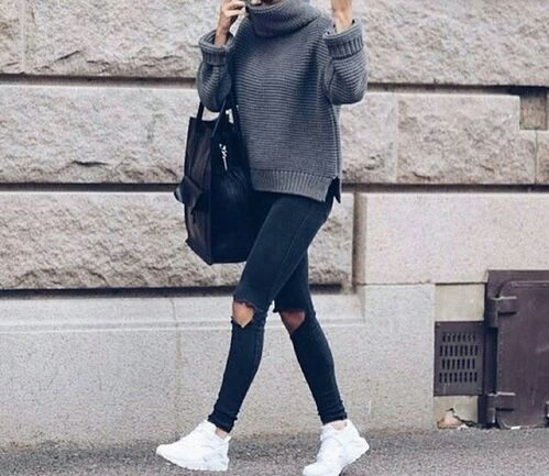 how to wear black distressed skinny jeans, white sneakers, a ribbed gray sweater and black tote