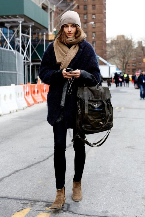 how to layer a scarf and knit hat over black skinny jeans and a black tote with brown ankle boots for a casual weekend look