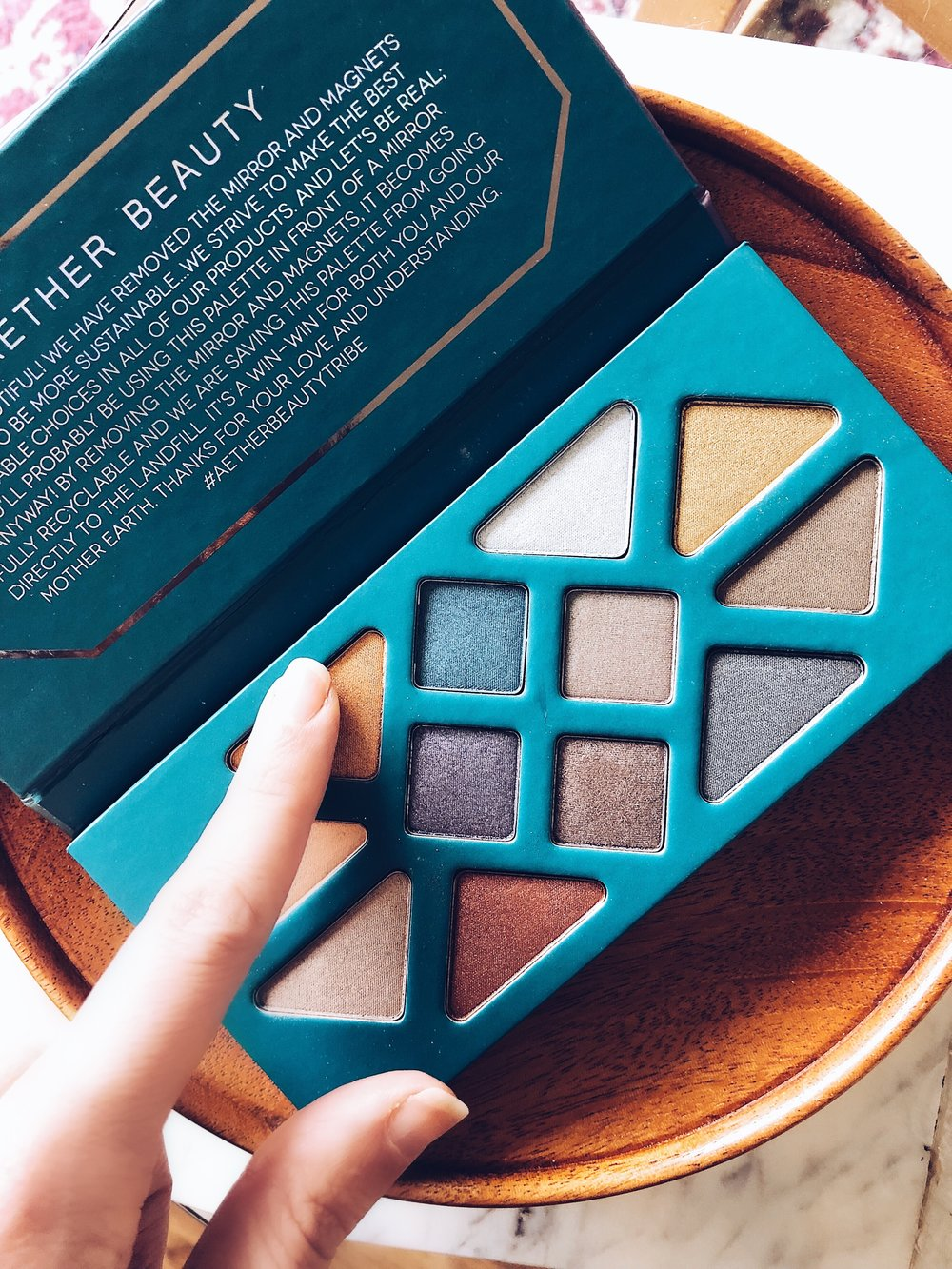 Aether Beauty Crystal Grid Gemstone Palette- $58 - Here's the quick SCORECARD breakdown. Each question is rated on a scale of 1 to 5, 5 being the best:1. How do the ingredients look (EWG.org ratings)?- 4: really solid!2. How is color pay off?- 5: I was blown away. No joke, this shadow performs!3. How is application?- 5: It glides on. A little does go a long way, and fallout was minimal.4. Is it non-irritating?- 5: Yes! No issues and I wear contact lenses.5. How about creasing?- 5: I prime and set prior to applying. Zero creasing issues.6. Does it last all day?- 5: Again, a prime and set helped. No reapplication was needed!7. How conscious is the brand? Cruelty free, sustainable, etc.- 5: If I could give it a '6' I would.FINAL SCORE:34/35