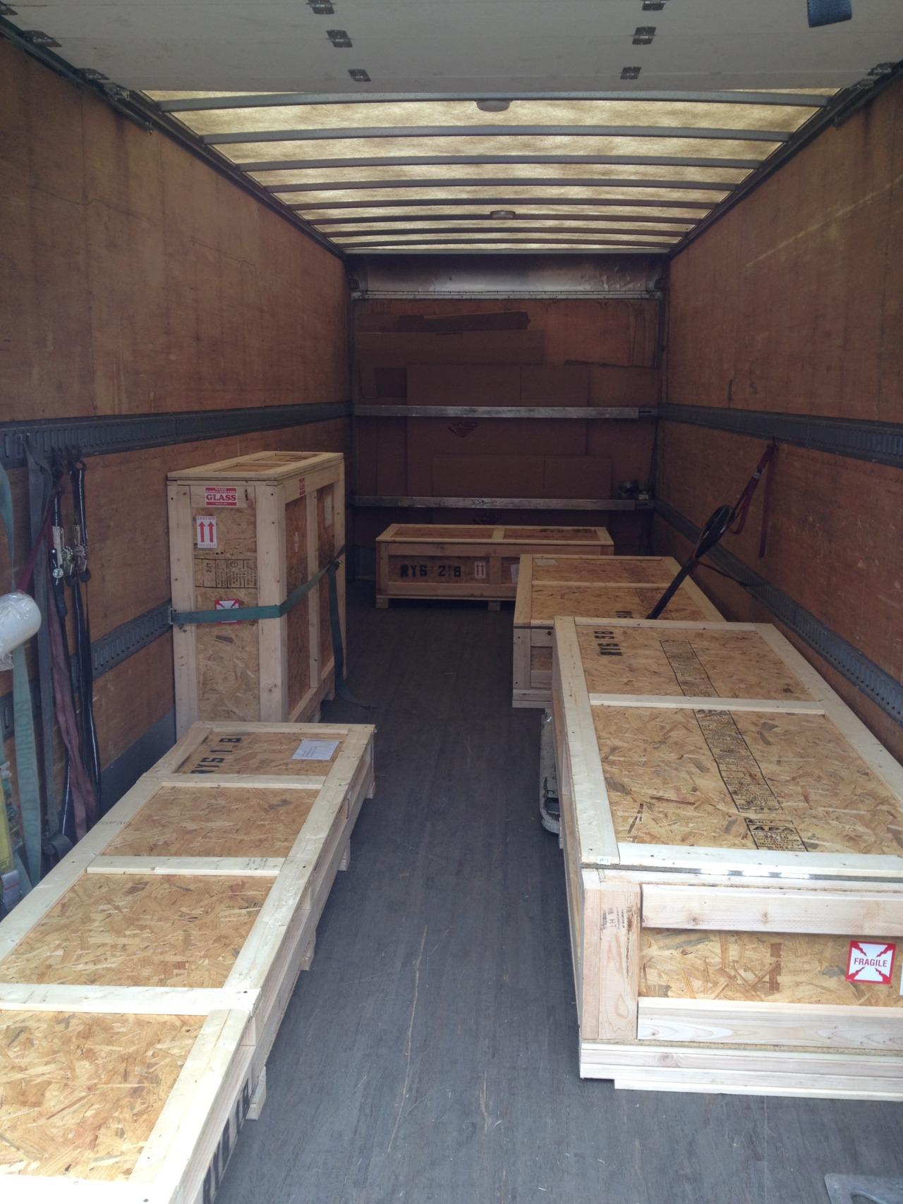 We get lots of questions about how we ship things. Maybe this will help answer some of those questions. This is two conference tables and a Sleepers coffee table headed to the west coast with an LTL carrier Ceva. FWIW, the folks at Ceva rock! Thanks to John Murphy for turning us onto them.